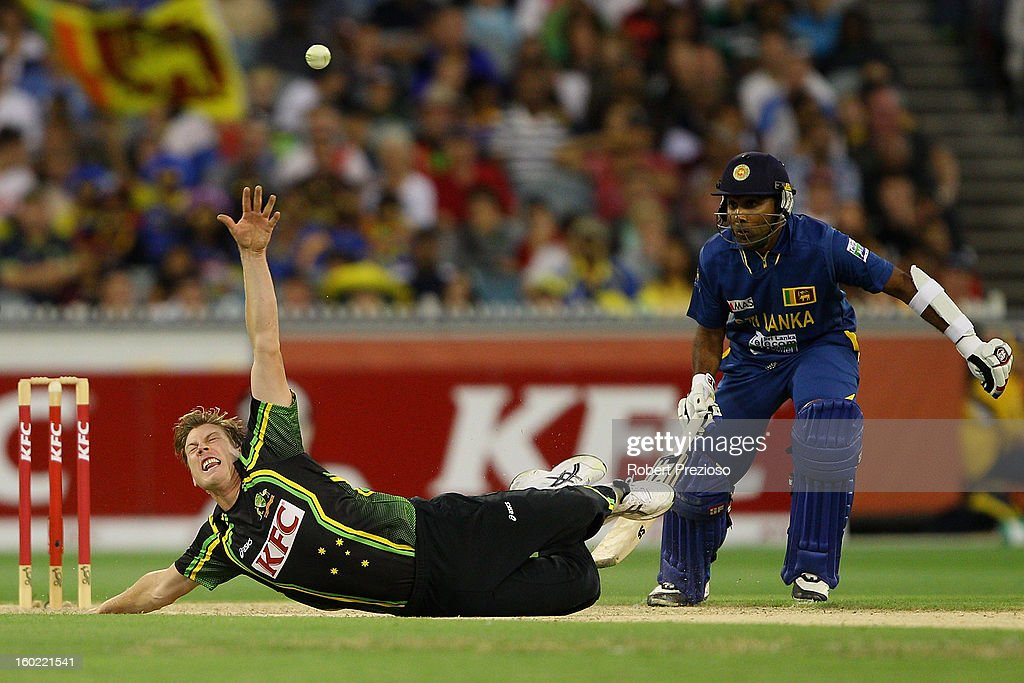 James Faulkner of Australia attempts to field the ball off his own bowling after falling during game two of the Twenty20 International series between Australia and Sri Lanka at Melbourne Cricket Ground on January 28, 2013 in Melbourne, Australia.