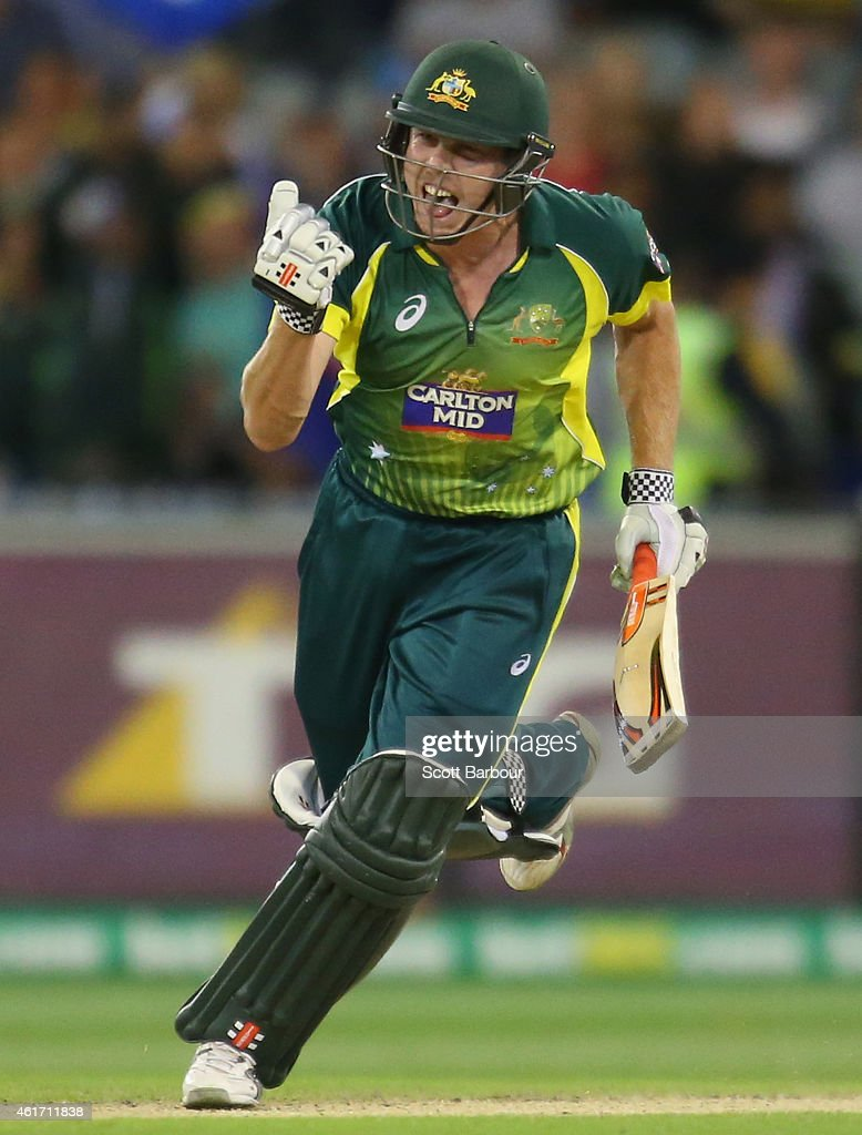 James Faulkner of Australia celebrates as he hits the winning runs during the One Day International match between Australia and India at the...