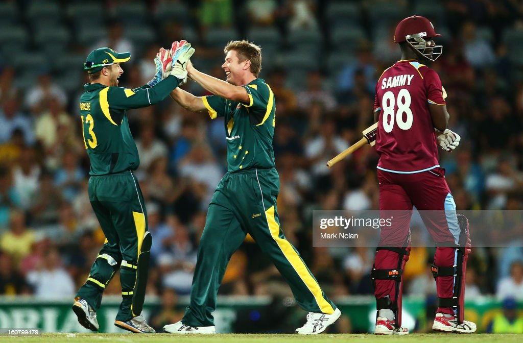 James Faulkner (C) of Australia celebrates bowling Darren Sammy of the West Indies during the Commonwealth Bank One Day International Series between Australia and the West Indies at Manuka Oval on February 6, 2013 in Canberra, Australia.