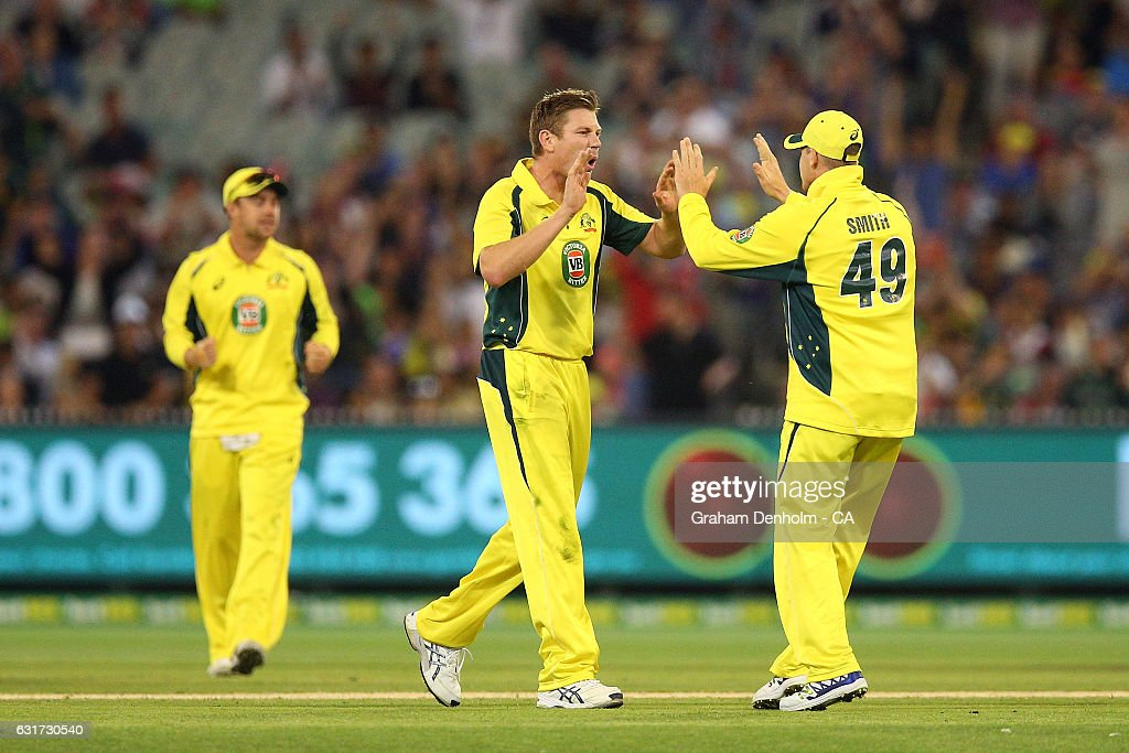 James Faulkner of Australia (C) celebrates the dismissal of Mohammad Hafeez of Pakistan during game two of the One Day International series between Australia and Pakistan at Melbourne Cricket Ground on January 15, 2017 in Melbourne, Australia.
