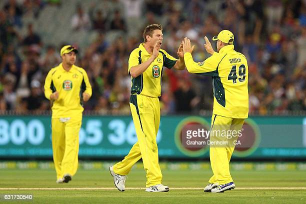 James Faulkner of Australia celebrates the dismissal of Mohammad Hafeez of Pakistan during game two of the One Day International series between...