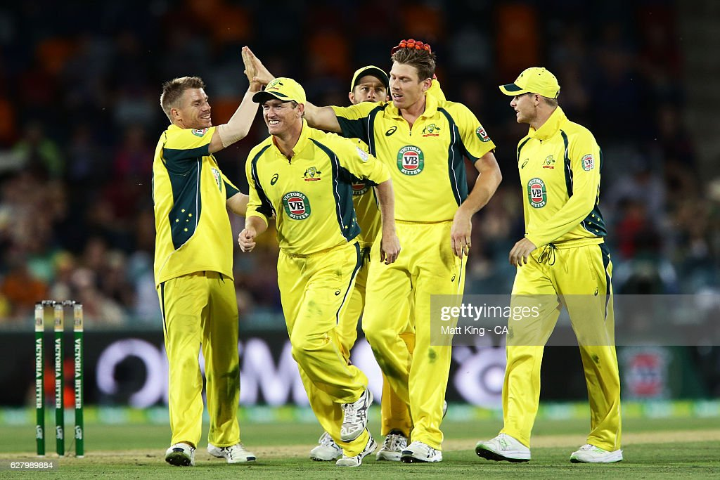 James Faulkner of Australia celebrates with team mates after taking the wicket of Colin Munro of New Zealand during game two of the One Day International series between Australia and New Zealand at Manuka Oval on December 6, 2016 in Canberra, Australia.