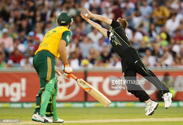 James Faulkner of Australia dives to take a catch to dismiss Rilee Rossouw of South Africa during game two of the International Twenty20 Series...