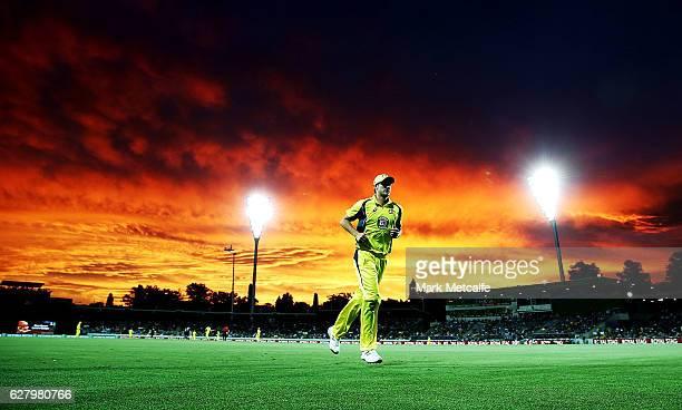 James Faulkner of Australia fields near the boundary rope as the sun sets during game two of the One Day International series between Australia and...