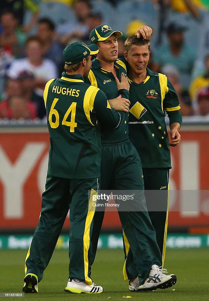 James Faulkner of Australia is congratulated by team mates after taking a catch to get the wicket of Darren Bravo of the West Indies during game five of the Commonwealth Bank International Series between Australia and the West Indies at Melbourne Cricket Ground on February 10, 2013 in Melbourne, Australia.
