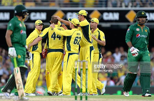 James Faulkner of Australia is congratulated by team mates after taking the wicket of Sharjeel Khan of Pakistan during game one of the One Day...