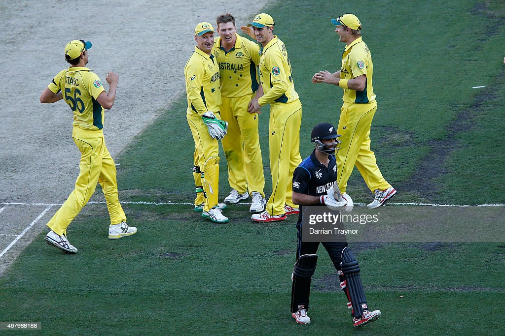 <a gi-track='captionPersonalityLinkClicked' href=/galleries/search?phrase=James+Faulkner+-+Cricketer&family=editorial&specificpeople=11388189 ng-click='$event.stopPropagation()'>James Faulkner</a> of Australia lets Grant Elliot of New Zealand know he took his wicket during the 2015 ICC Cricket World Cup final match between Australia and New Zealand at Melbourne Cricket Ground on March 29, 2015 in Melbourne, Australia.