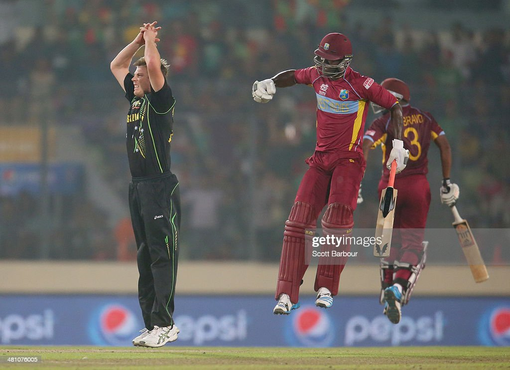 James Faulkner of Australia reacts as <a gi-track='captionPersonalityLinkClicked' href=/galleries/search?phrase=Darren+Sammy&family=editorial&specificpeople=2920912 ng-click='$event.stopPropagation()'>Darren Sammy</a> (C) of the West Indies hits a six in the final over during the ICC World Twenty20 Bangladesh 2014 match between Australia and the West Indies at Sher-e-Bangla Mirpur Stadium on March 28, 2014 in Dhaka, Bangladesh.