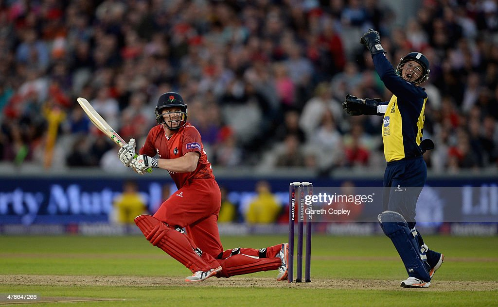 <a gi-track='captionPersonalityLinkClicked' href=/galleries/search?phrase=James+Faulkner+-+Cricketer&family=editorial&specificpeople=11388189 ng-click='$event.stopPropagation()'>James Faulkner</a> of Lancashire bats watched by Birmingham Bears wicketkeeper <a gi-track='captionPersonalityLinkClicked' href=/galleries/search?phrase=Tim+Ambrose&family=editorial&specificpeople=757624 ng-click='$event.stopPropagation()'>Tim Ambrose</a> during the NatWest T20 Blast match between Lancashire Lighting and Birmingham Bears at Old Trafford on June 26, 2015 in Manchester, England.