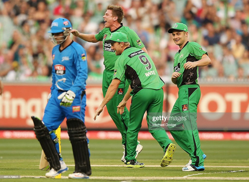 James Faulkner (C) of the Stars celebrates his dismissal of Phil Hughes of the Strikers with <a gi-track='captionPersonalityLinkClicked' href=/galleries/search?phrase=Cameron+White&family=editorial&specificpeople=178931 ng-click='$event.stopPropagation()'>Cameron White</a> and Luke Wright (R) during the Big Bash League match between the Melbourne Stars and the Adelaide Strikers at the Melbourne Cricket Ground on January 9, 2014 in Melbourne, Australia.