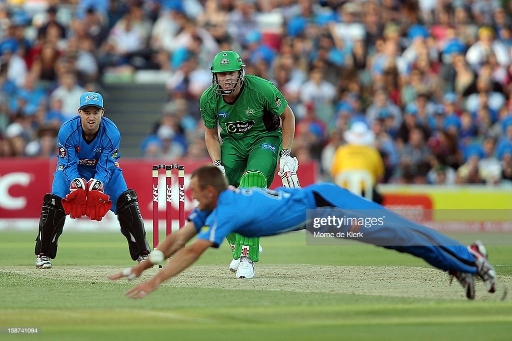 James Faulkner of the Stars gets the balll away during the Big Bash League match between the Adelaide Strikers and the Melbourne Stars at Adelaide Oval on December 27, 2012 in Adelaide, Australia.