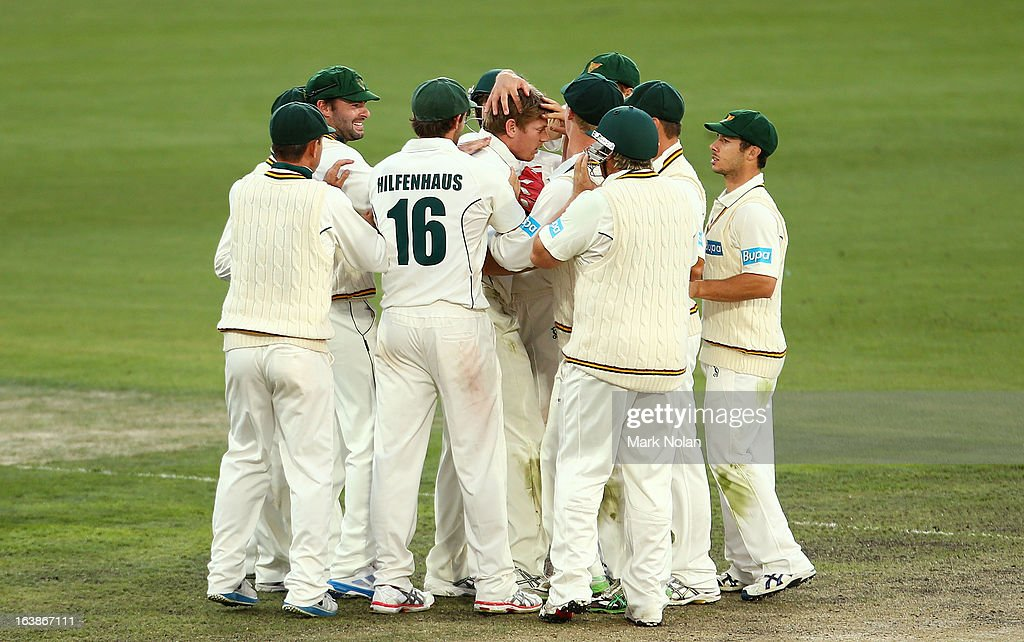 James Faulkner of the Tigers is congratulated by team mates after taking a wicket during day four of the Sheffield Shield match between the Tasmania Tigers and the Victoria Bushrangers at Blundstone Arena on March 17, 2013 in Hobart, Australia.