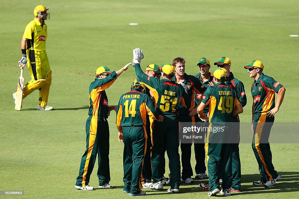 James Faulkner of the Tigers is congratulated by team mates after dismissing Michael Hussey of the Warriors during the Ryobi One Day Cup match between the Western Australia Warriors and the Tasmanian Tigers at the WACA on February 19, 2013 in Perth, Australia.