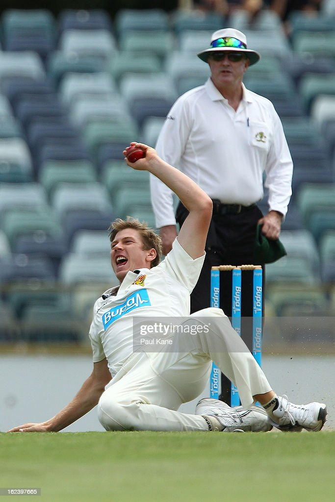 James Faulkner of the Tigers takes a catch off his own bowling to dismiss Liam Davis of the Warriors during day three of the Sheffield Shield match between the Western Australia Warriors and the Tasmania Tigers at WACA on February 23, 2013 in Perth, Australia.