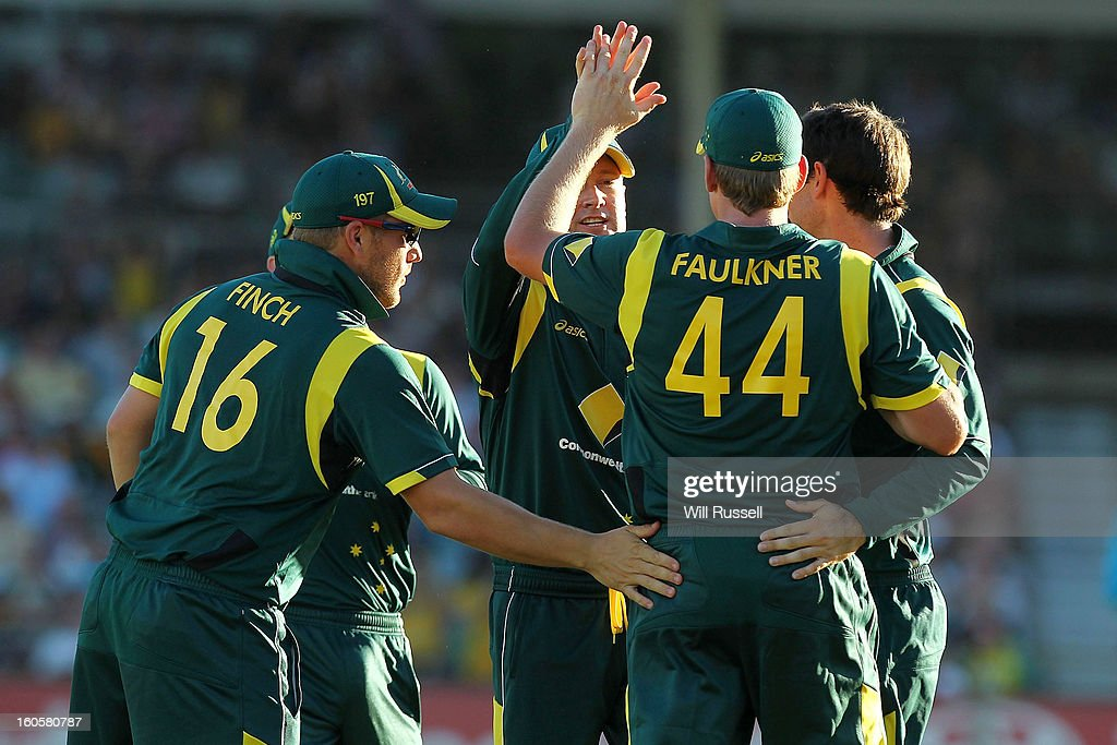 James Faulknerof Australia is congratulated by team-mates after taking a catch off Darren Sammy of the West Indies during game two of the Commonwealth Bank One Day International Series between Australia and the West Indies at WACA on February 3, 2013 in Perth, Australia.