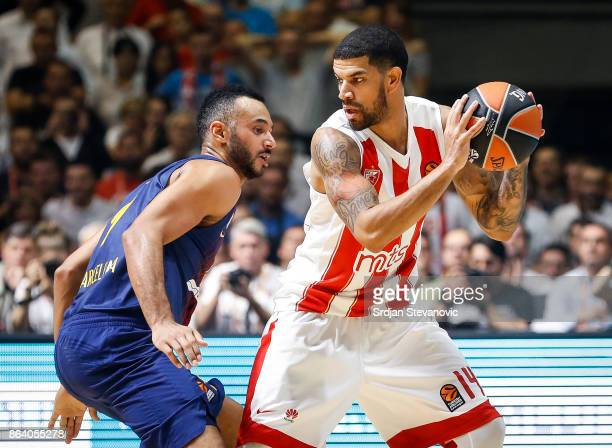 James Feldeine of Crvena Zvezda in action against Adam Hanga of Barcelona during the 2017/2018 Turkish Airlines EuroLeague Regular Season game...