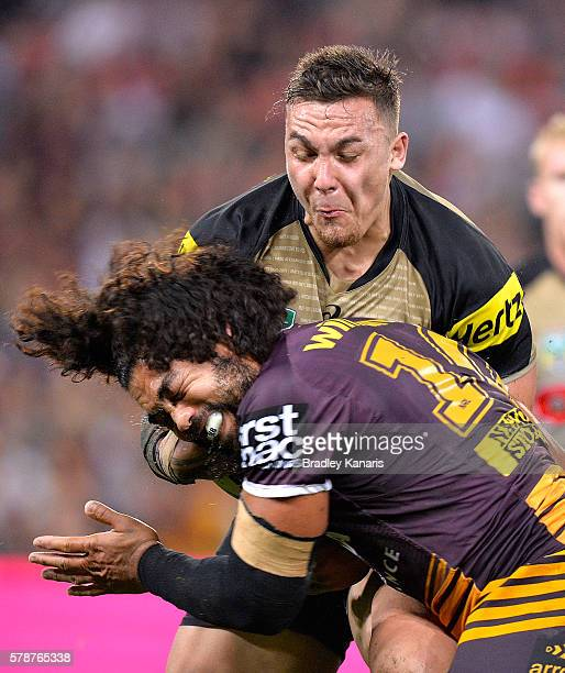 James FisherHarris of the Panthers takes on the defence of Adam Blair of the Broncos during the round 20 NRL match between the Brisbane Broncos and...