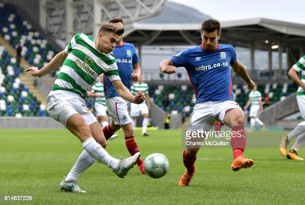 James Forrest of Celtic and Matthew Clarke of Linfield during the Champions League second round first leg qualifying game between Linfield and Celtic...