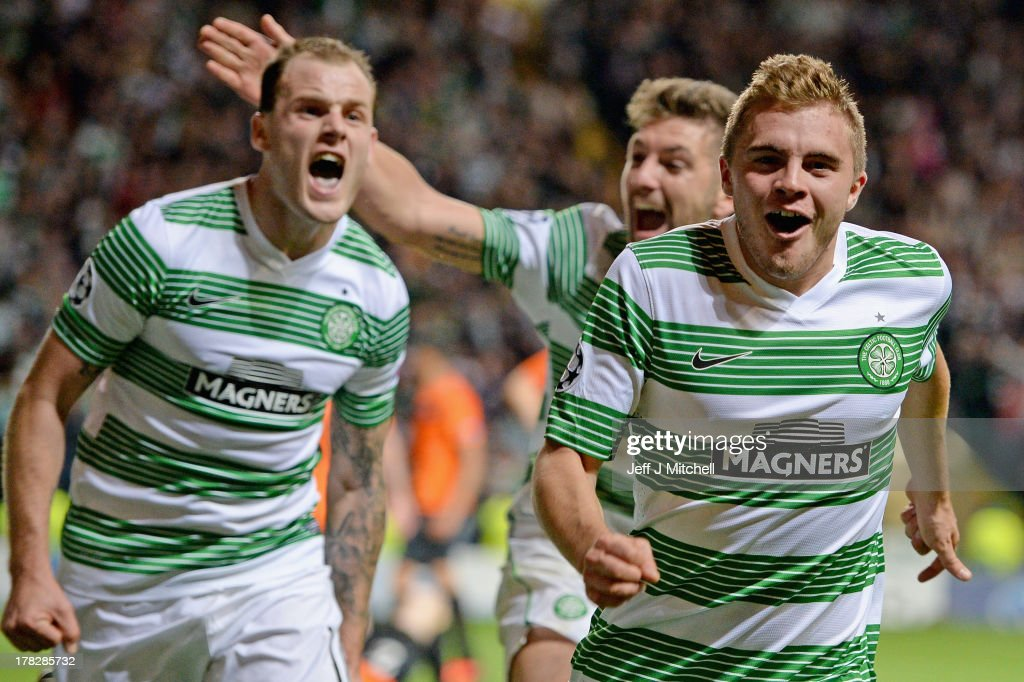 James Forrest (R) of Celtic celebrtaes after scoring their third goal during the UEFA Champions League Play-off second leg match between Celtic and Shakhter Karagandy at Celtic Park on August 28, 2013 in Glasgow,Scotland.