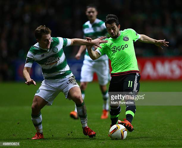 James Forrest of Celtic challenges Amin Younes of Ajax during the UEFA Europa League Group A match between Celtic FC and AFC Ajax on November 26 2015...