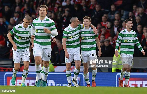 James Forrest of Celtic is congratulated by his team mates after scoring Celtic's second goal of the game during the Betfred Cup Final between...