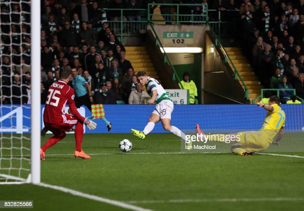 James Forrest of Celtic scores his team's fourth goal during the UEFA Champions League Qualifying PlayOffs Round First Leg match between Celtic FC...