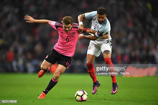 James Forrest of Scotland and Kyle Walker of England compete for the ball during the FIFA 2018 World Cup Qualifier between England and Scotland at...