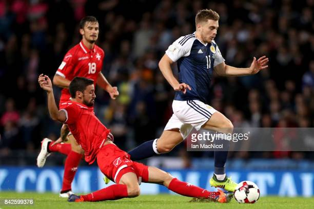 James Forrest of Scotland evades Ryan Fenech of Malta Ikechi during the FIFA 2018 World Cup Qualifier between Scotland and Malta at Hampden Park on...