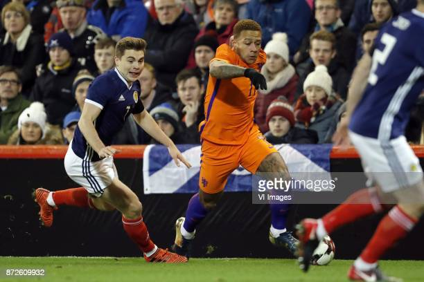 James Forrest of Scotland Memphis Depay of Holland Ryan Jack of Scotland during the friendly match between Scotland and The Netherlands on November...