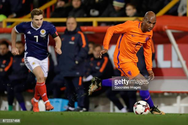 James Forrest of Scotland Ryan Babel of Holland during the International Friendly match between Scotland v Holland at the Pittodrie Stadium on...