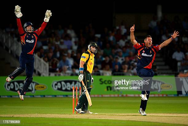 James Foster and David Masters of Essex Eagles celebrate the wicket of Michael Lumb of Nottinghamshire Outlaws during the Freinds Life T20 Quarter...