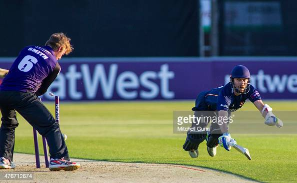 James Foster of Essex dives to make his ground as Tom Smith of Gloucestershire attempts to run him out during the NatWest T20 blast match between...