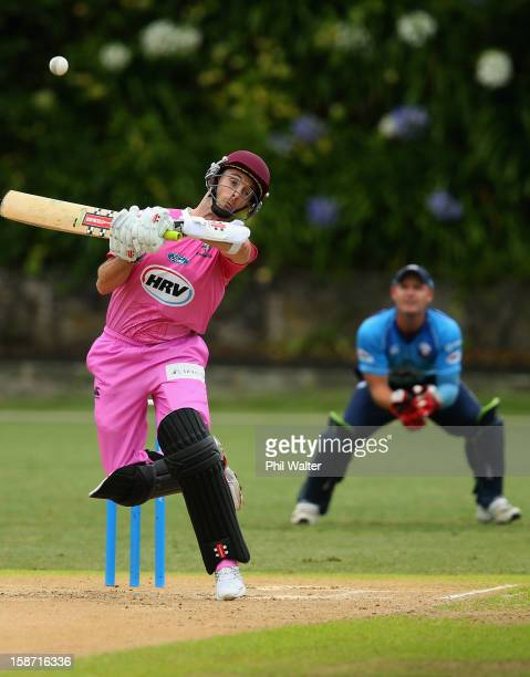 James Foster of Northern Districts gets an edge to be caught by Gareth Hopkins of Auckland during the HRV Cup Twenty20 match between the Auckland...