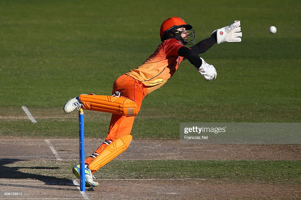 James Foster of Virgo dives to stop the ball reaching the boundary during the Oxigen Masters Champions League match between Gemini Arabians and Virgo Super Kings on February 6, 2016 in Sharjah, United Arab Emirates.