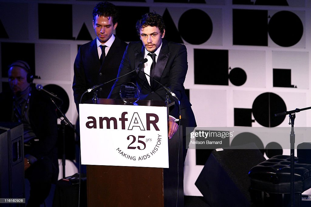 <a gi-track='captionPersonalityLinkClicked' href=/galleries/search?phrase=James+Franco&family=editorial&specificpeople=577480 ng-click='$event.stopPropagation()'>James Franco</a> accepts his award on stage during the 2nd Annual amfAR Inspiration Gala at The Museum of Modern Art on June 14, 2011 in New York City.
