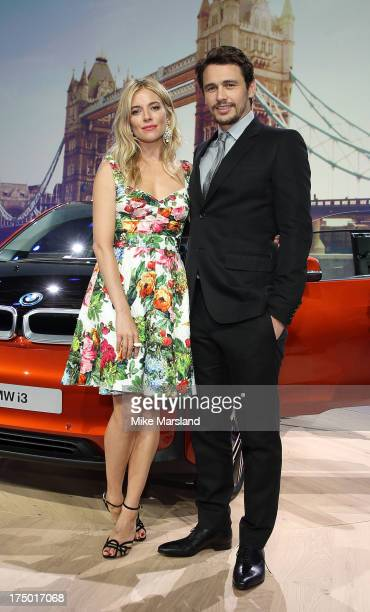 James Franco and Sienna Miller attend the BMWi3 global reveal party at Old Billingsgate Market on July 29 2013 in London England