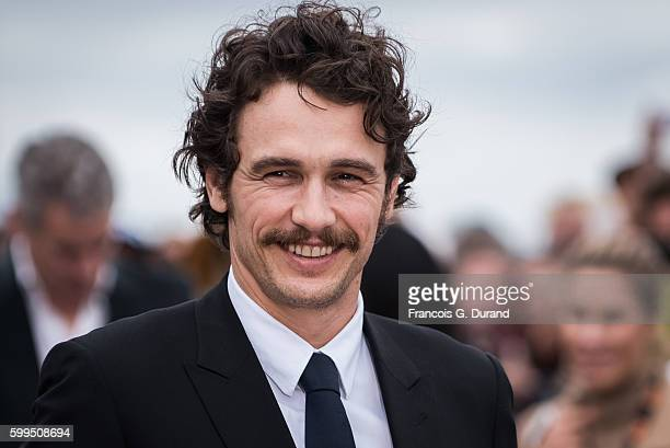 James Franco poses for photographers after unveiling his dedicated beach locker room during the 42nd Deauville American Film Festival on September 5...