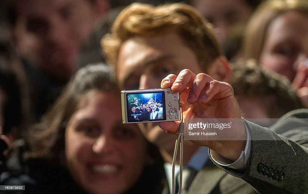 James Franco poses with the members of the public as he arrives for the 'Oz: The Great And Powerful' European premiere at the Empire Leicester Square on February 28, 2013 in London, England.