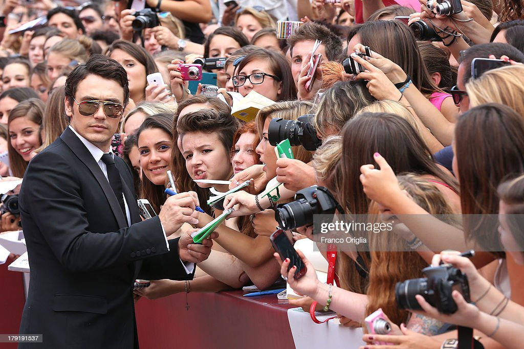 <a gi-track='captionPersonalityLinkClicked' href=/galleries/search?phrase=James+Franco&family=editorial&specificpeople=577480 ng-click='$event.stopPropagation()'>James Franco</a> signs autographs the 'Palo Alto' Premiere during the 70th Venice International Film Festival at the Sala Grande on September 1, 2013 in Venice, Italy.