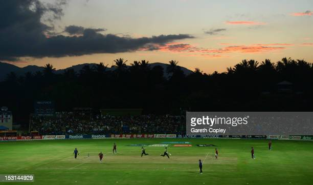 James Franklin and Ross Taylor of New Zealand run between the wickets during the ICC World Twenty20 2012 Super Eights Group 1 match between the West...