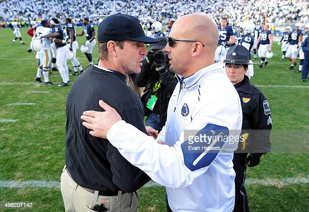 James Franklin head coach of the Penn State Nittany Lions congratulates Jim Harbaugh head coach of the Michigan Wolverines after the game at Beaver...