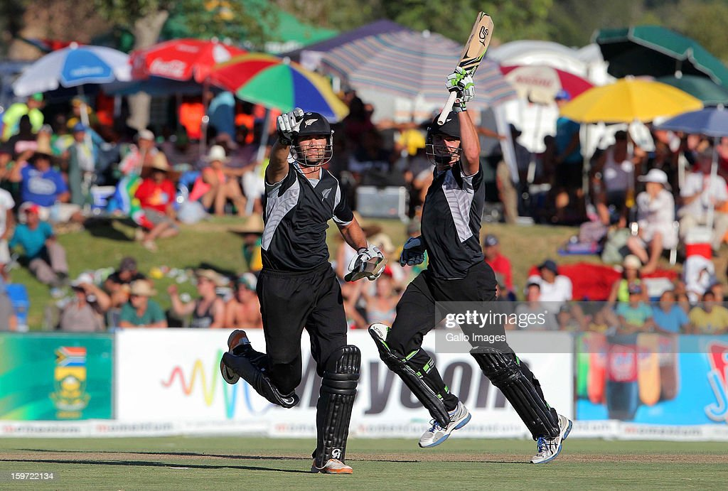 James Franklin (L) of New Zealand celebrates hitting the winning runs next to Mitchell McClenaghan during the 1st One Day International match between South Africa and New Zealand at Boland Park on January 19, 2013 in Paarl, South Africa.