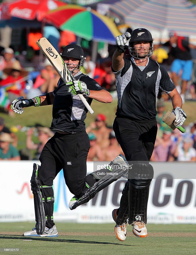James Franklin (R) of New Zealand celebrates hitting the winning runs next to Mitchell McClenaghan during the 1st One Day International match between South Africa and New Zealand at Boland Park on January 19, 2013 in Paarl, South Africa.