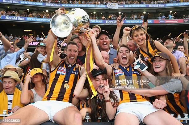 James Frawley and Isaac Smith of the Hawks celebrate with the crowd after winning the 2015 AFL Grand Final match between the Hawthorn Hawks and the...