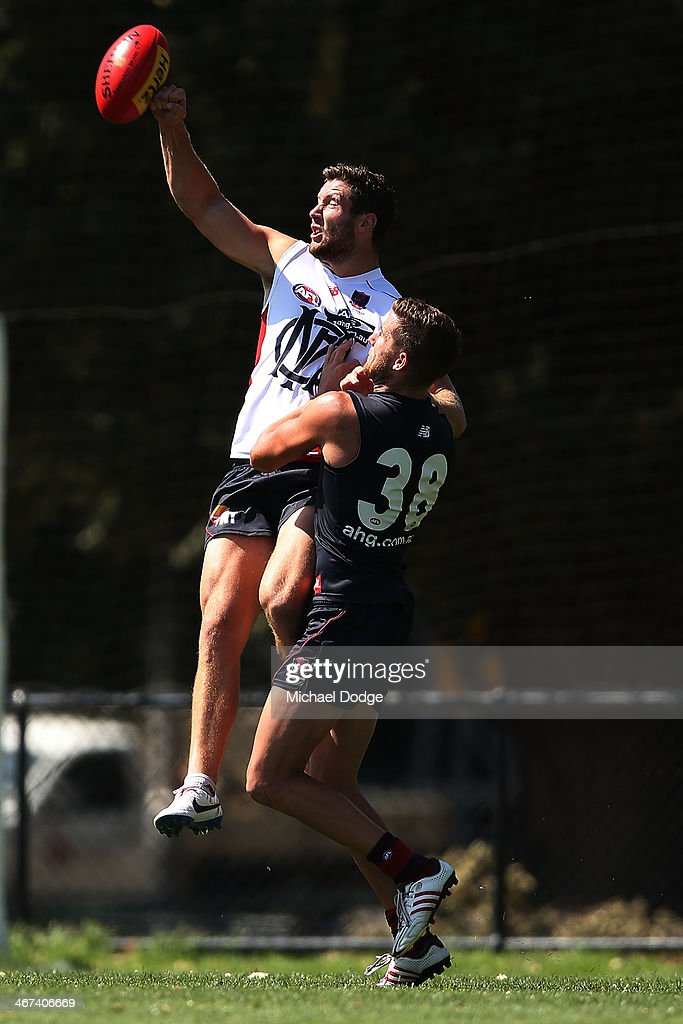 James Frawley (L) and Jeremy Howe contest for the ball during a Melbourne Demons AFL training session at Gosch's Paddock on February 7, 2014 in Melbourne, Australia.