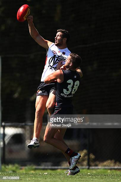 James Frawley and Jeremy Howe contest for the ball during a Melbourne Demons AFL training session at Gosch's Paddock on February 7 2014 in Melbourne...
