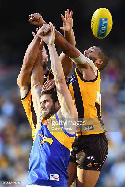 James Frawley and Josh Gibson of the Hawks spoil a mark by Jack Darling of the Eagles during the round two AFL match between the Hawthorn Hawks and...