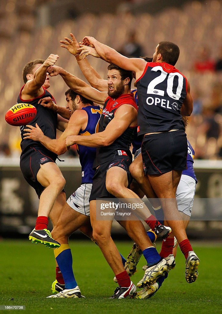 James Frawley of the Demons spoils the ball during the round three AFL match between the Melbourne Demons and the West Coast Eagles at Melbourne Cricket Ground on April 13, 2013 in Melbourne, Australia.