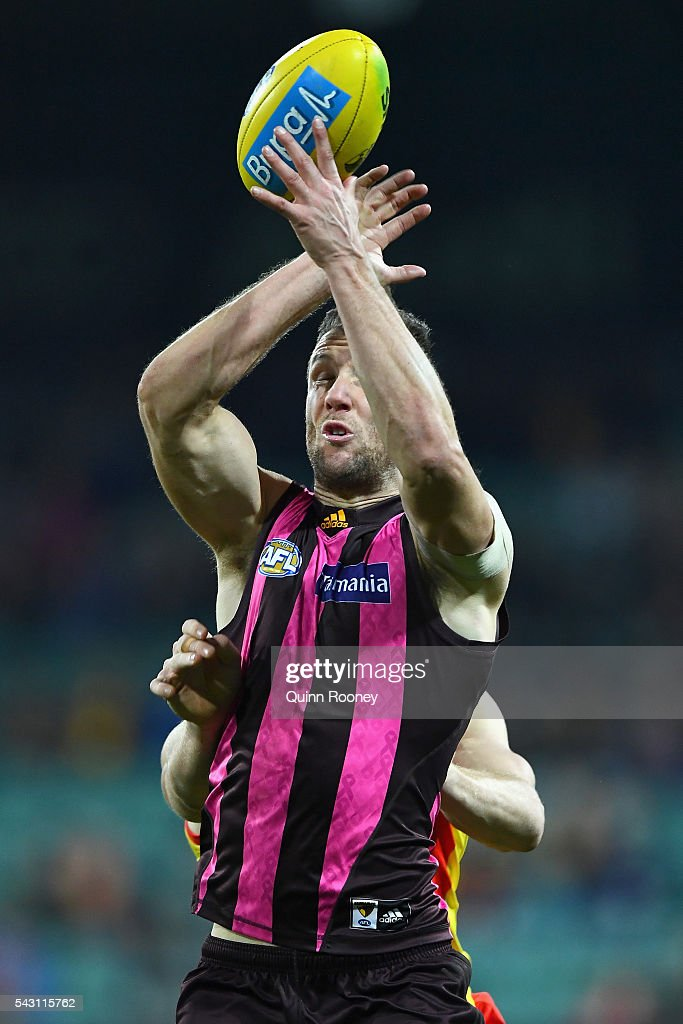 James Frawley of the Hawks attempts to mark infront of Tom Lynch of the Suns during the round 14 AFL match between the Hawthorn Hawks and the Gold Coast Suns at Aurora Stadium on June 26, 2016 in Launceston, Australia.