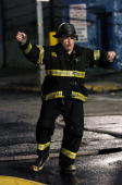 James Gandolfini dances in the street while dressed as a firefighter as he films a dream sequence from the upcoming movie 'Romance Cigarettes' on...